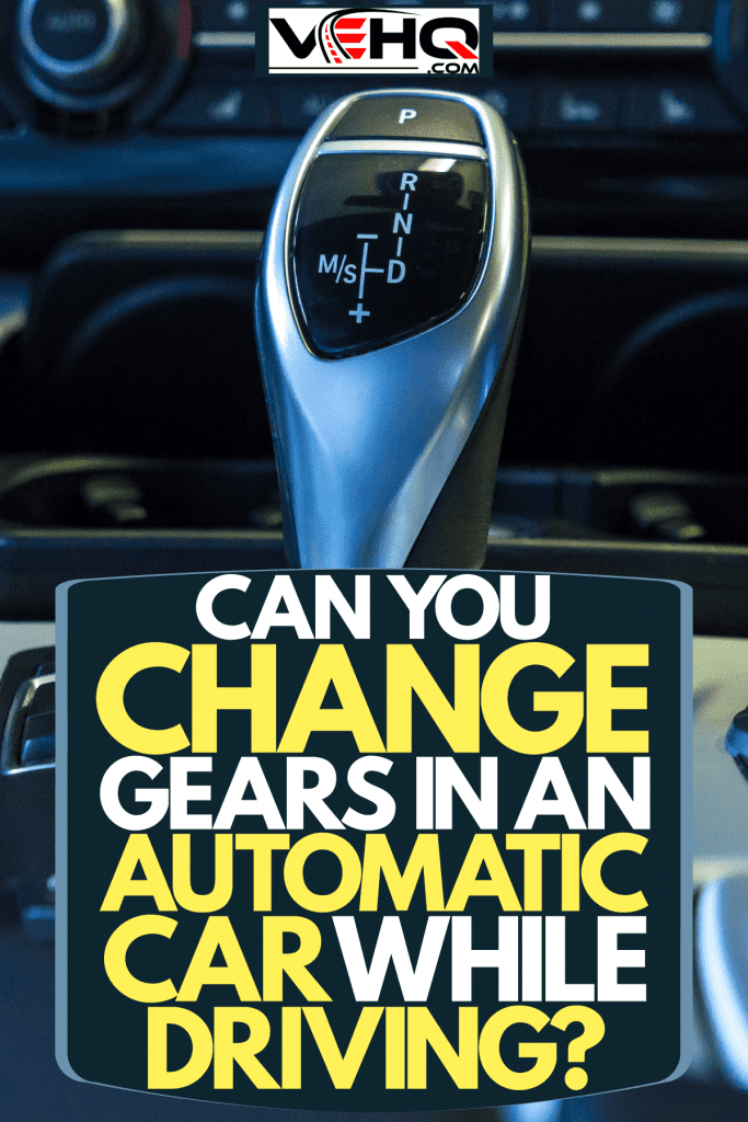 An automatic shifter of a car and other buttons seen on the dashboard, Can You Change Gears In An Automatic Car While Driving?