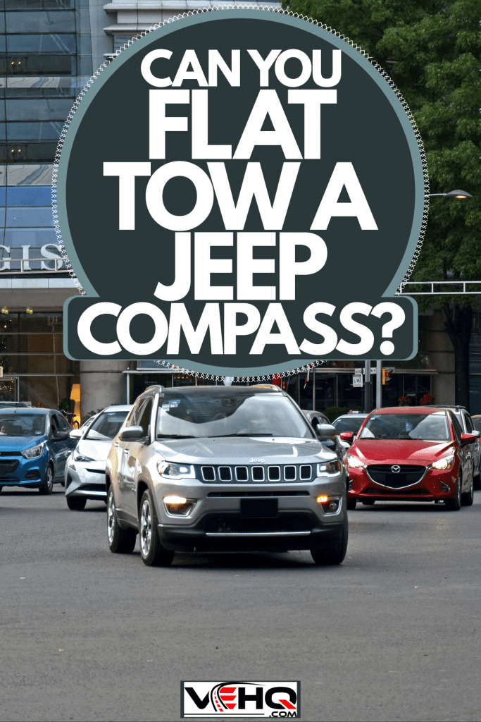 A Jeep Compass moving on the city streets, Can You Flat Tow A Jeep Compass?