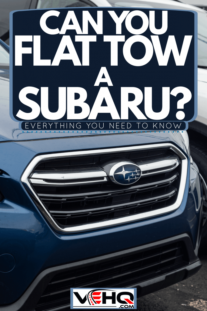 Different trims of Subaru parked outside a dealership, Can You Flat Tow A Subaru? [Everything You Need To Know]