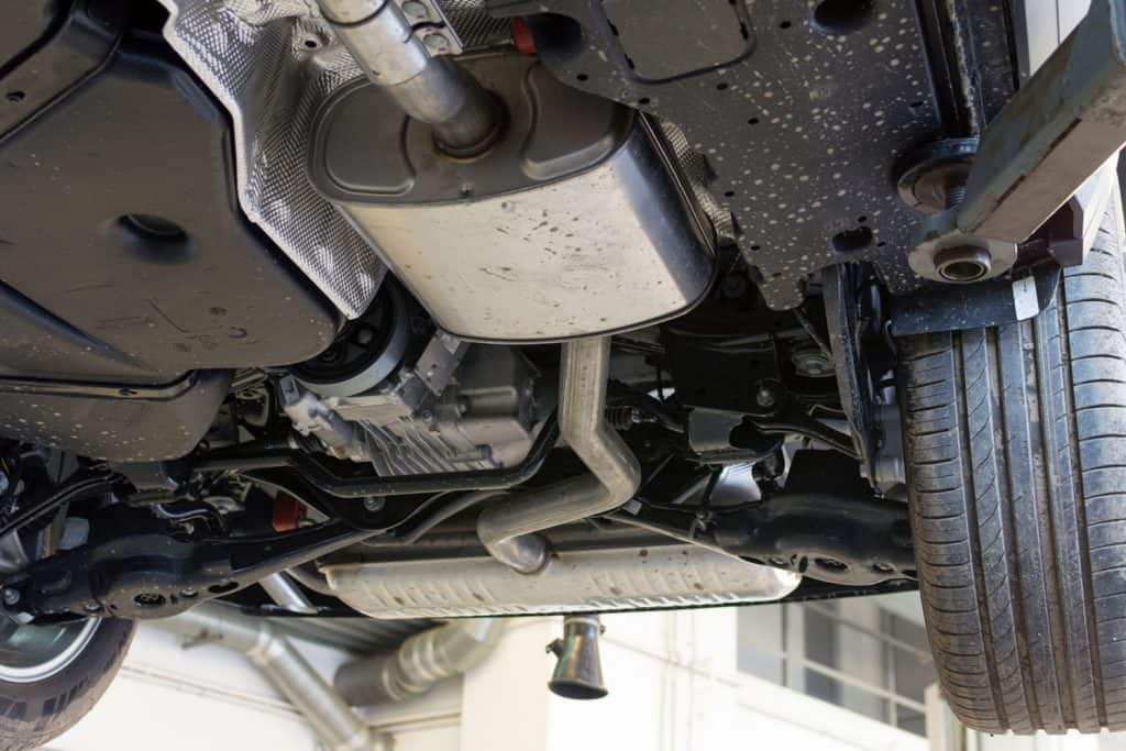 Catalytic converter. Car on a lift in a car service. View of the car from below, Clogged Catalytic Converter - How To Tell And What To Do?