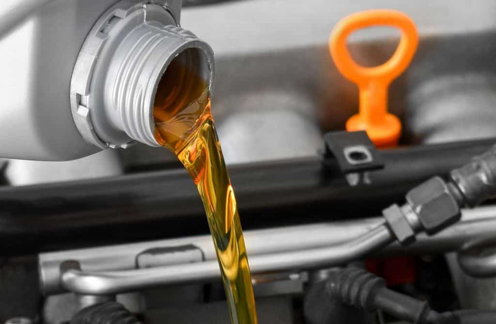 Close up of new motor oil on car engine