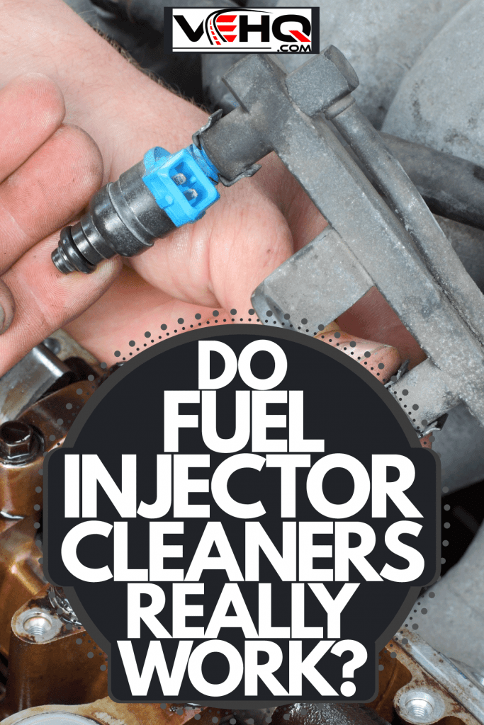 A mechanic checking the fuel injector of a car, Do Fuel Injector Cleaners Really Work?