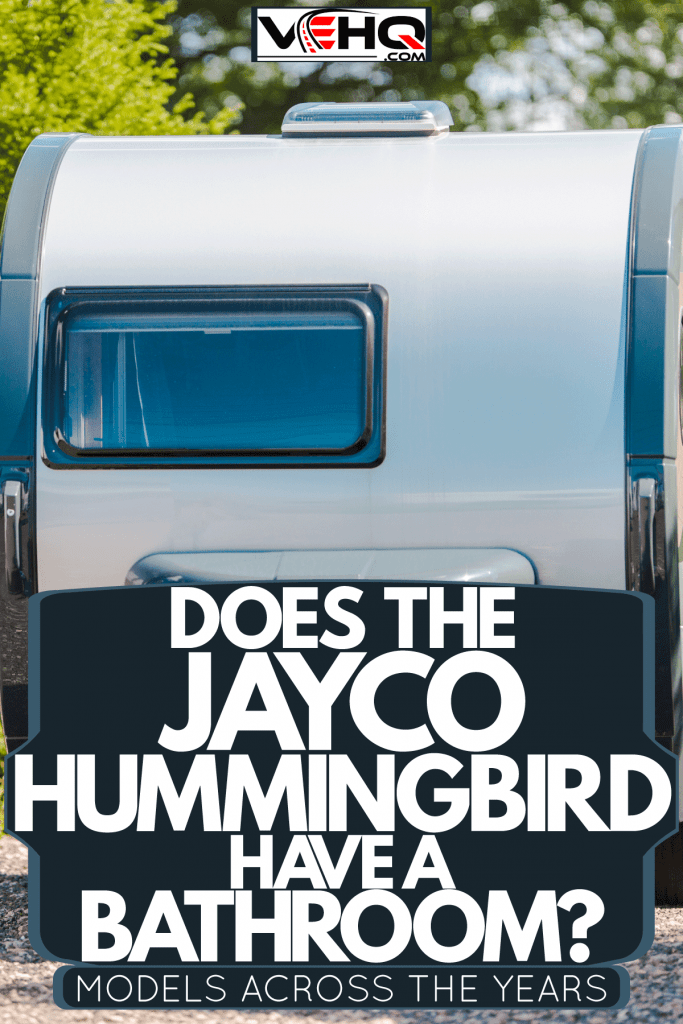 A travel trailer parked on the side of a camping ground, Does The Jayco Hummingbird Have A Bathroom? [Models Across The Years]
