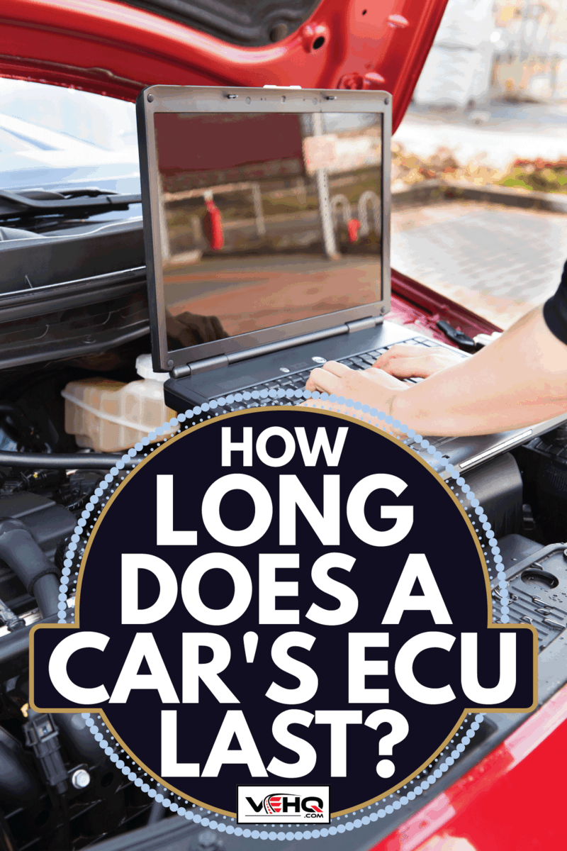 Hand Working In Auto Repair Service. How Long Does A Car's ECU Last