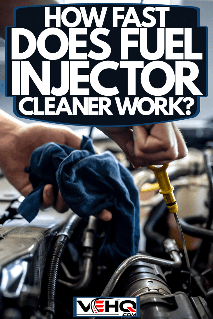 A mechanic checking the engine of car, How Fast Does Fuel Injector Cleaner Work?