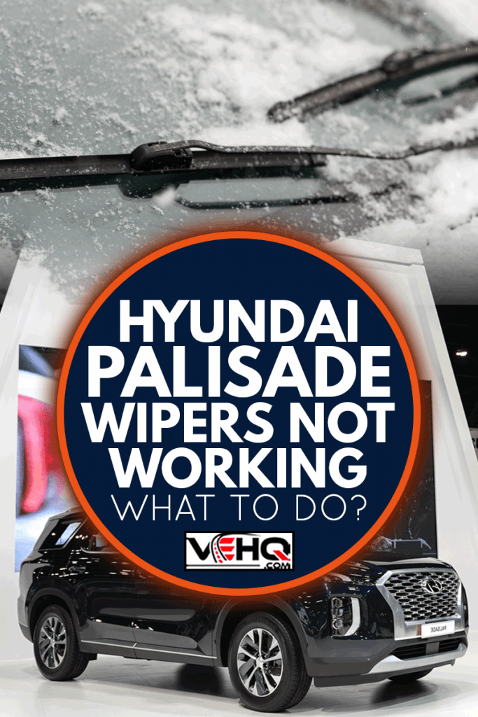 Car wiper blades clean snow from car windows. Flakes of snow covered the car with a thick layer, Hyundai Palisade Wipers Not Working - What To Do?