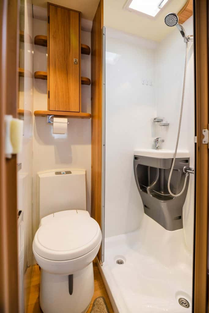 Luxury large open plan motor home interior with seating area and table for several occupants, How Big Is An RV Shower?