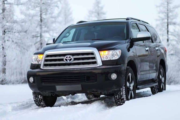 Off-road vehicle Toyota Sequoia SUV in the snow covered forest, What SUVs Have The Highest Ground Clearance?