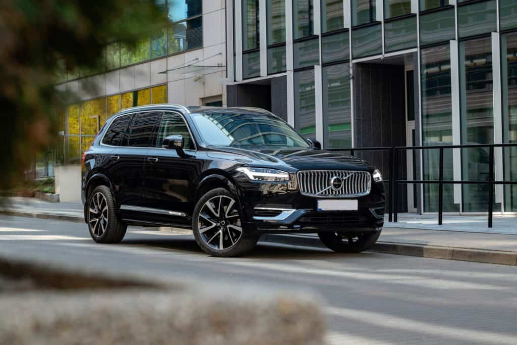 Plug-in hybrid SUV Volvo XC90 Recharge on a street. This model is the most luxury vehicle in Volvo offer.