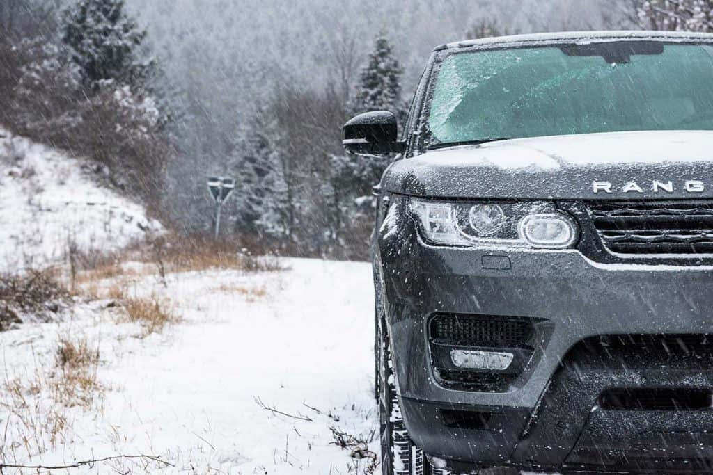 SUV off-road vehicle on a snowy mountain