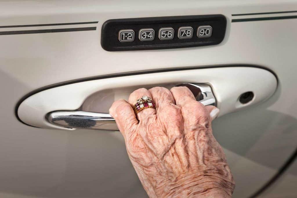 Senior woman opening car door