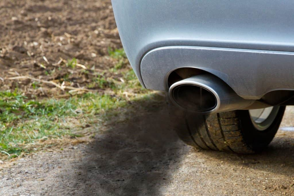 Smoking exhaust pipe of a car