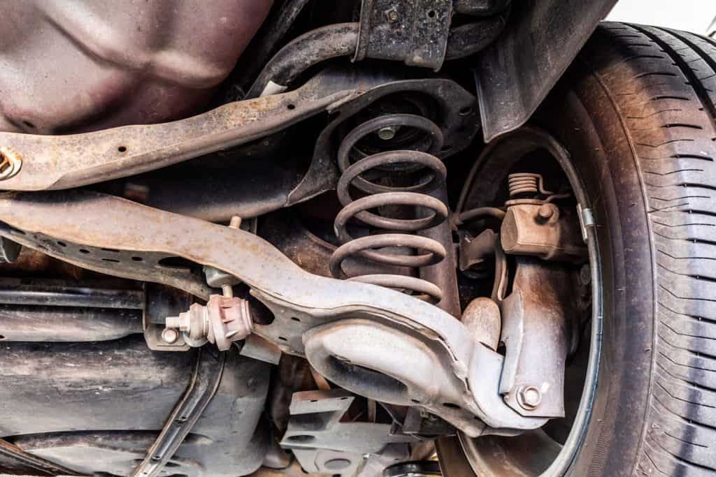 Used vehicle shock absorber and control arm in a repair shop