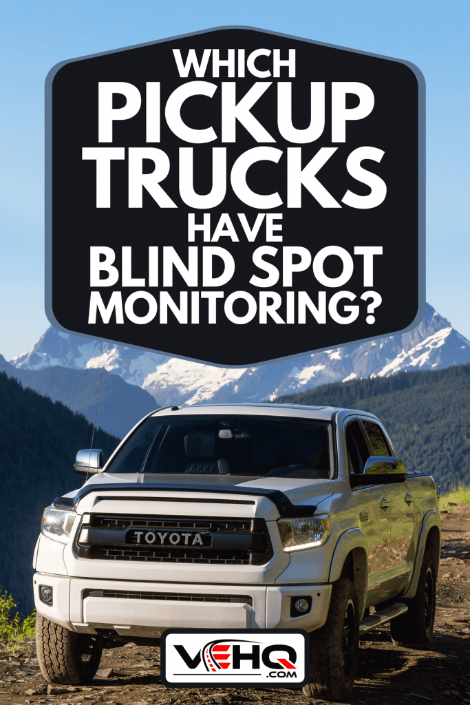 A Toyota Tacoma on 4x4 offroad trails in the mountains, Which Pickup Trucks Have Blind Spot Monitoring?