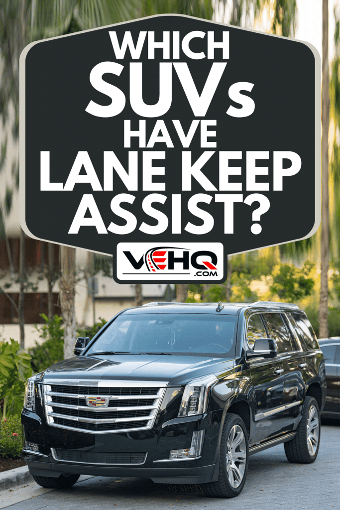 A luxury limon SUV Cadillac Escalade at parking lot, Which SUVs Have Lane Keep Assist?