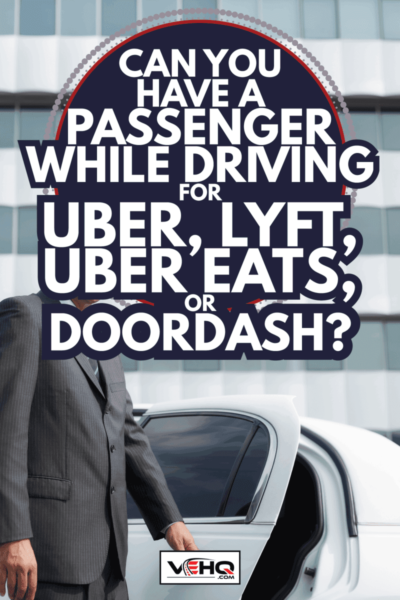 adult man working as driver Opening Car Door For Passenger. Can You Have A Passenger While Driving For Uber, Lyft, Uber Eats, Or Doordash