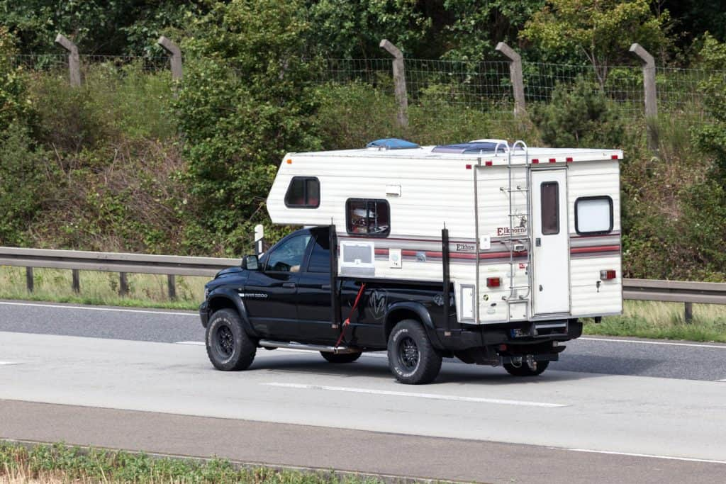 A Dodge Ram Truck Camper on the road