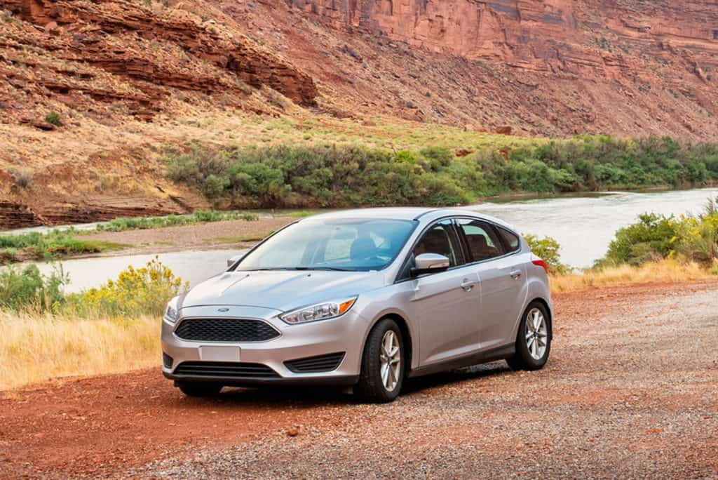A Ford Focus is parked on the side of Utah state route 128 scenic byway aka The River Road near Moab, Utah, USA on an overcast day,How Much Weight Can A Ford Focus Carry?