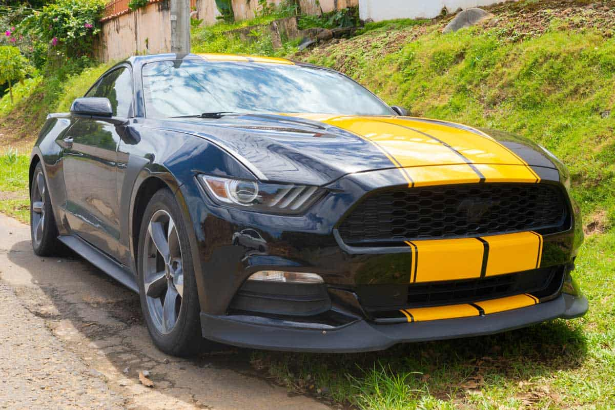 A black and yellow Mustang car parked in a city street, Ford Mustang Key Not Working - What To Do?
