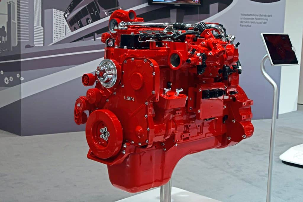 A gorgeous red colored cummins engine for dispay at a cars show