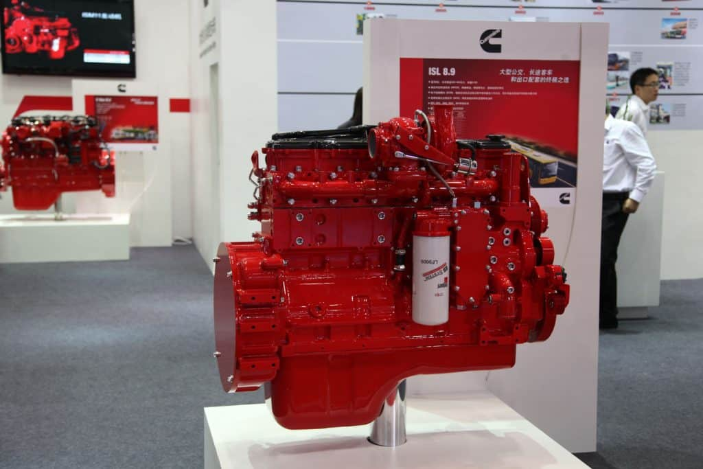 A huge and powerful red painted cummins engine at a car show