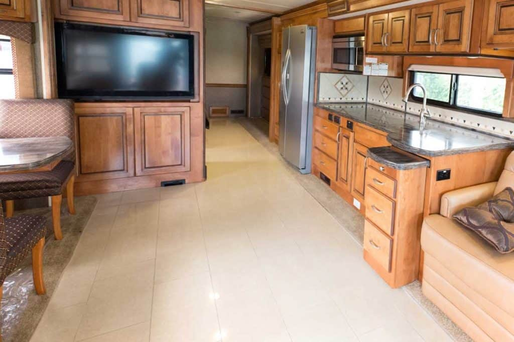 A view of the inside of a new RV mobile home, 9 Great RV Flooring Ideas To Consider