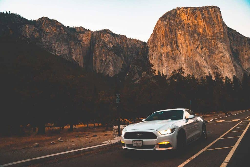 Beautiful white Ford Mustang GT parked in the heart of the Yosemite National park