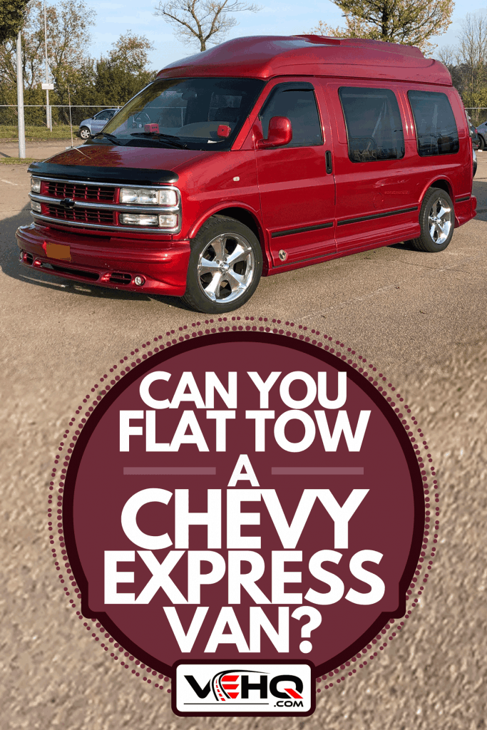 A Chevrolet Express work van parked on a public parking lot, Can You Flat Tow A Chevy Express Van?