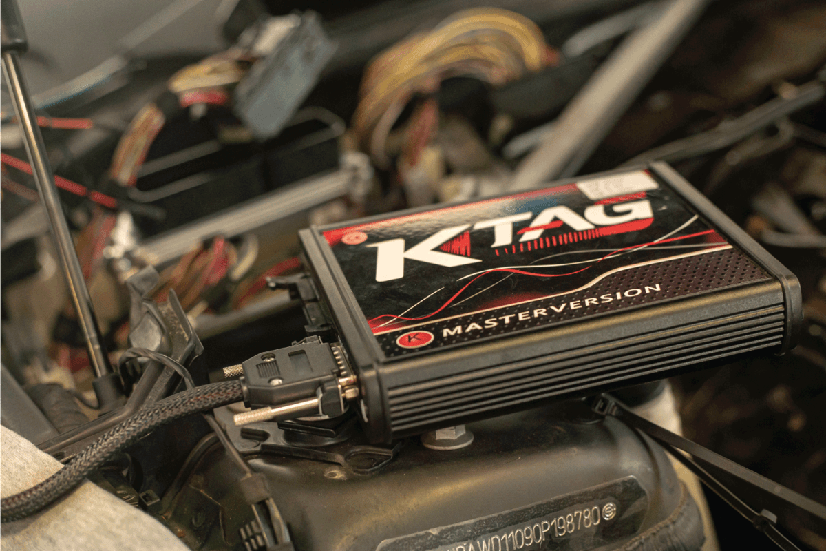 Car chip tuning detail for adding power, engine bay photo