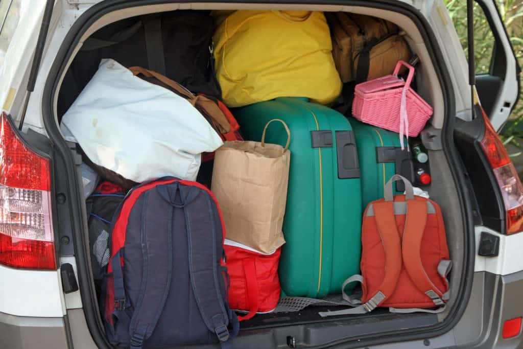Car full of suitcases and bags to return from summer holidays
