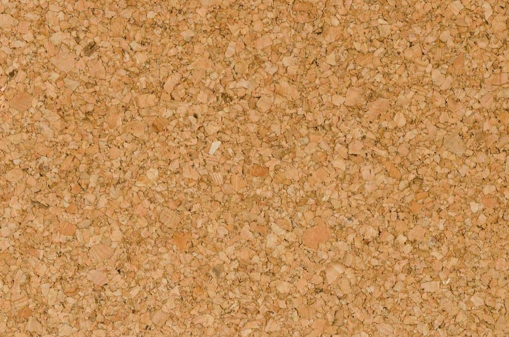 Close up texture detail in the surface of cork board wood background