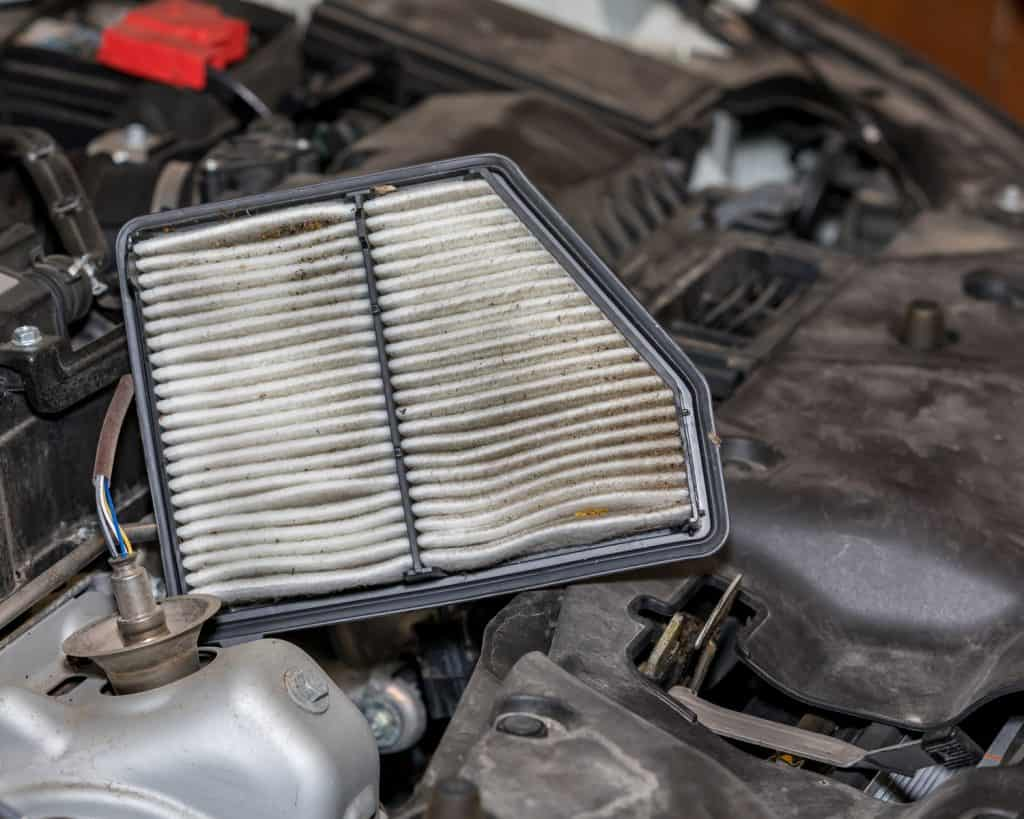 Dirty air filter for car engine. Concept of automobile maintenance and service