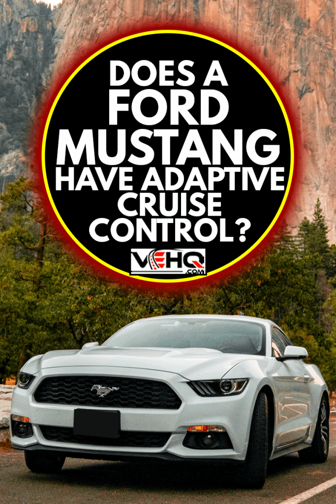 Beautiful white Ford Mustang GT parked in the heart of the Yosemite National park with amazing half dome cliffs around it, Does A Ford Mustang Have Adaptive Cruise Control?
