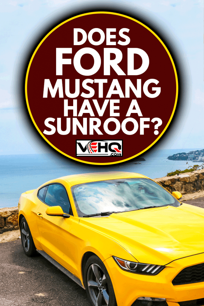 Yellow muscle car Ford Mustang in the city street, Does Ford Mustang Have A Sunroof?