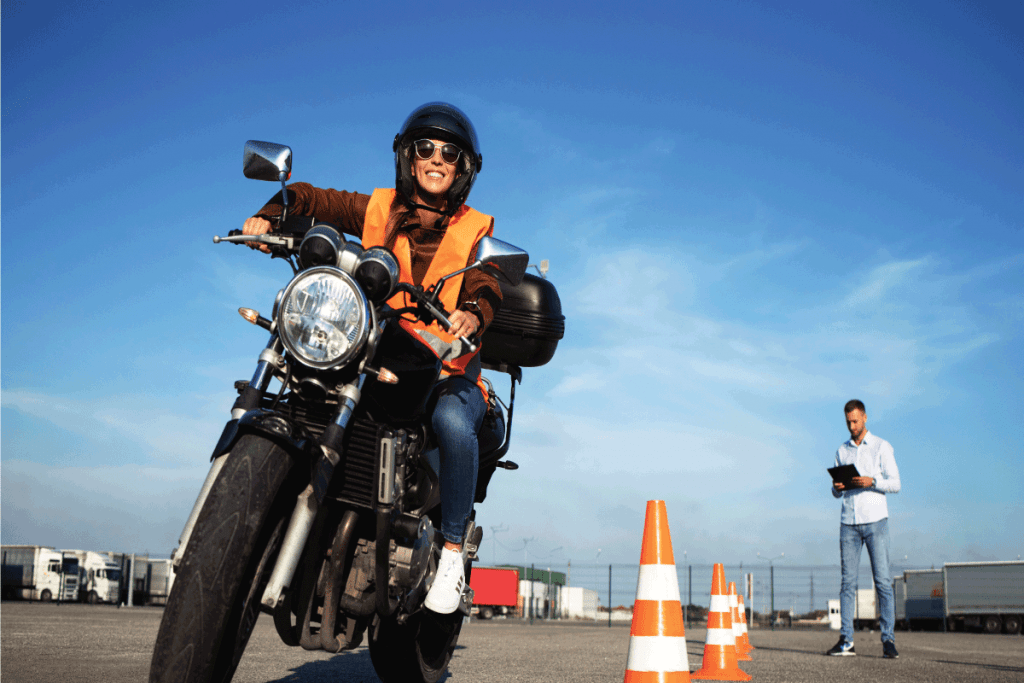 Female student with helmet taking motorcycle lessons and practicing ride. How To Get A Motorcycle License In Florida