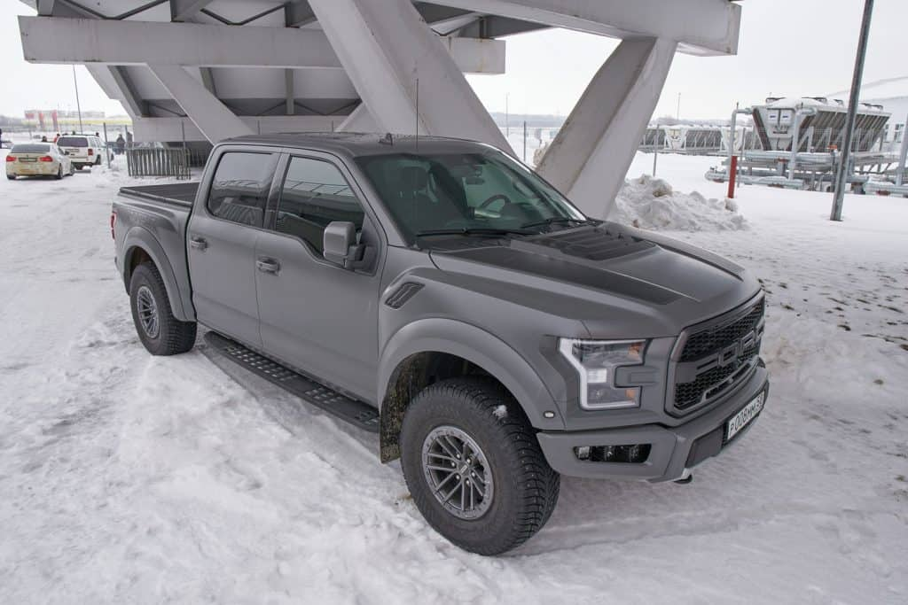 Ford F-150 Raptor on the parking, How Much Weight Can A Ford F150 Carry?