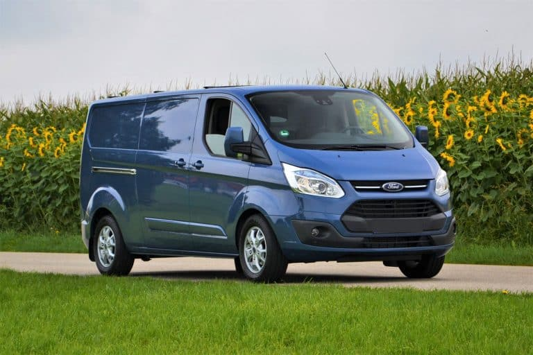 Ford Transit Custom stopped on the road. This model is one of the most popular delivery vans in Europe, How Much Weight Can A Ford Transit Carry?