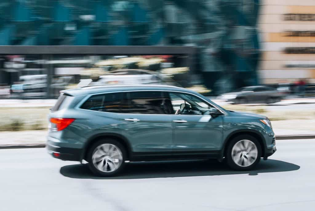 Gray Honda Pilot car moving on the street, Can You Flat Tow A Honda Pilot?