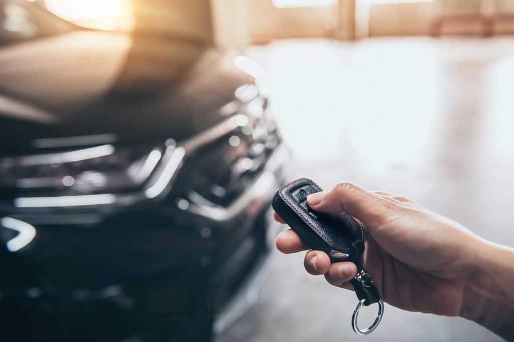Hand presses unlock on the car remote control