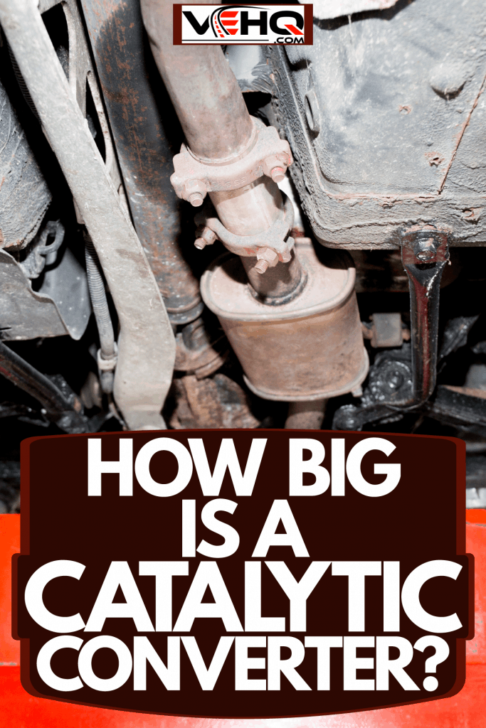An underside photo of a car showing the catalytic converter on the middle and the back suspension on the back, How Big Is A Catalytic Converter?