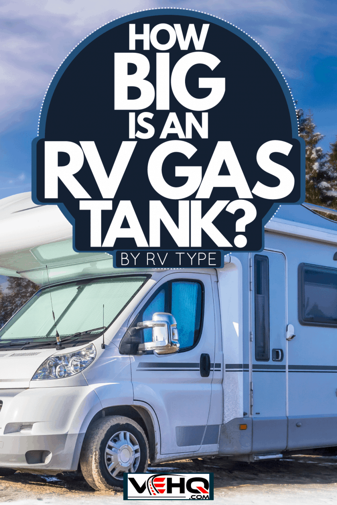 An expensive looking RV parked on the camping ground of a snow trail park, How Big Is An RV Gas Tank? [By RV Type]