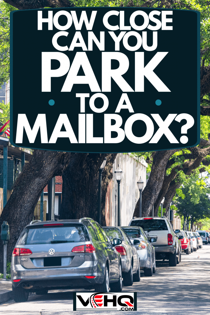 Cars parked on the side of the streets next to huge trees, How Close Can You Park To A Mailbox?