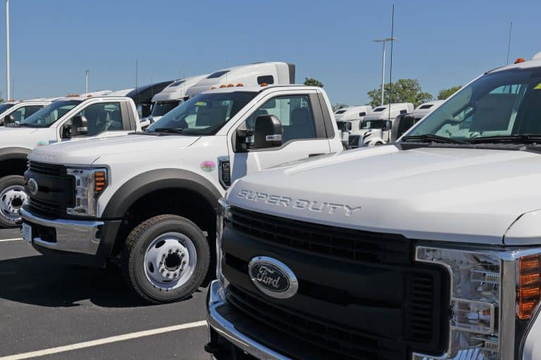 Huge white colored Ford F-550s parked outside a dealership, How Much Weight Can A Ford F-550 Carry?