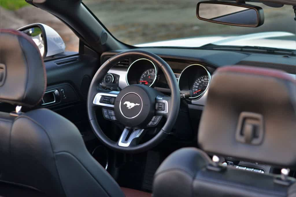 Interior in Ford Mustang Convertible. This elegant interior is made with high class materials, for example aluminium and cowhide