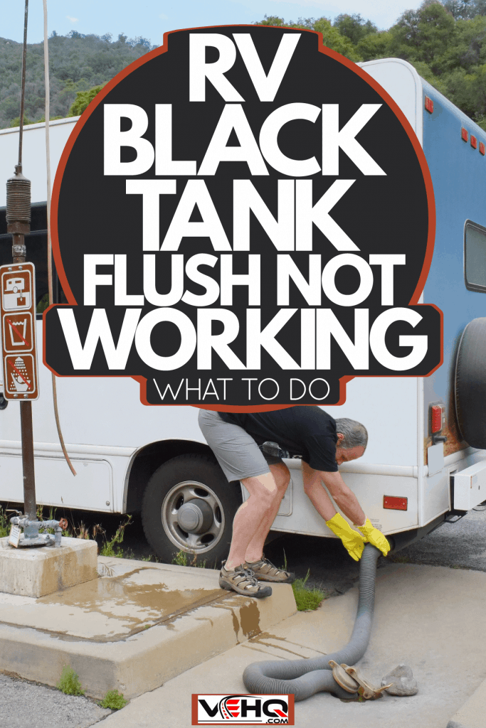 A man dumping waste water in his small motorhome to a designated dumping station, RV Black Tank Flush Not Working - What To Do