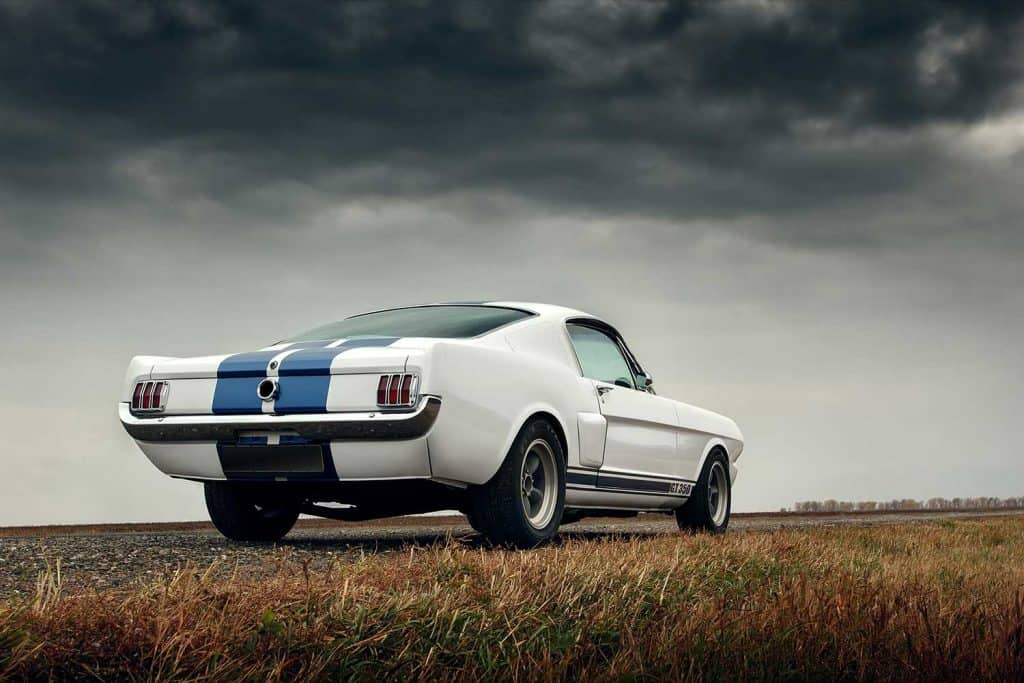 Retro muscle car Ford Mustang Shelby on the road