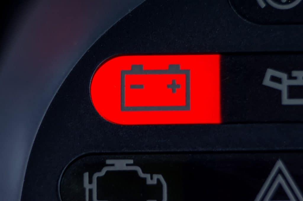 Screen symbols battery warning light in-car dashboard, close up