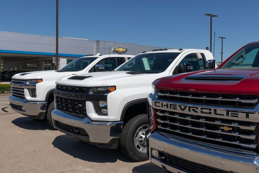Three different trims of Chevrolet 3500 trucks in different colors, How Much Weight Can A Chevy 3500 Carry?