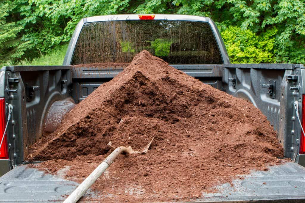 Unload mulch from a pickup truck