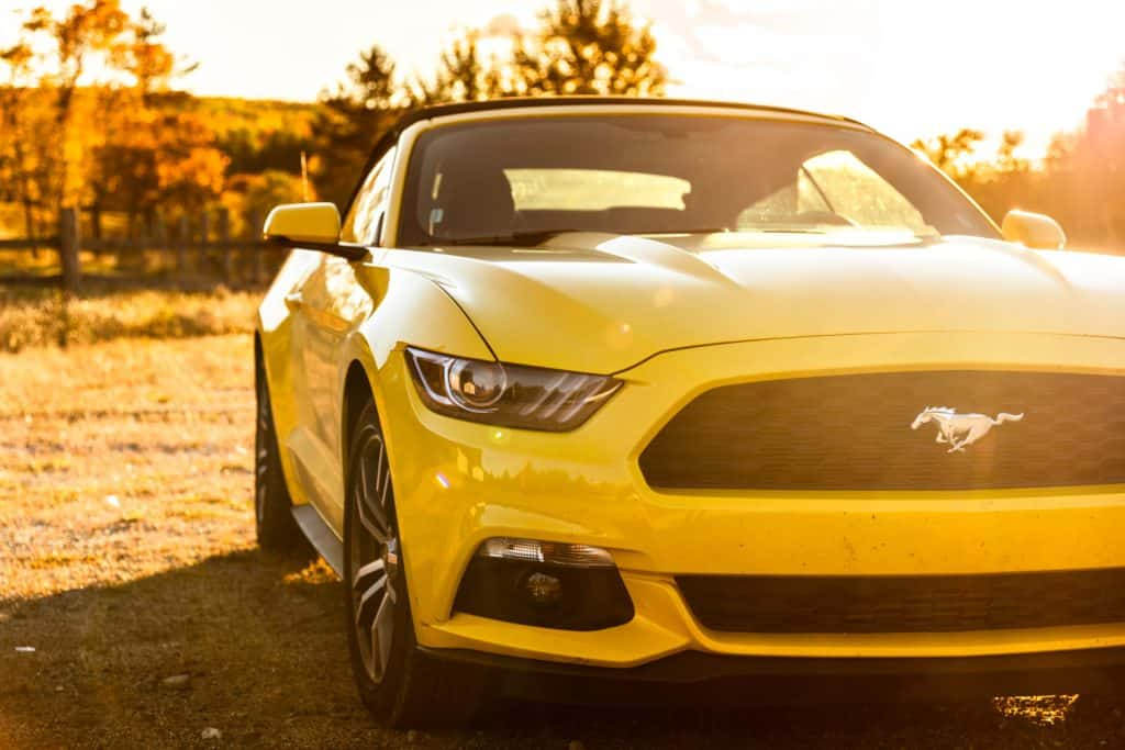 View of a yellow Ford Mustang GT convertible 2016 version parked on the countryside of Flagstaff in Maine at dusk. Ford Mustang is a sport coupe made by Ford.